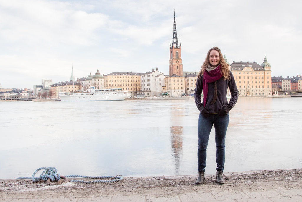 picture of Angela of Angela Travels in front of buildings in Stockholm, Sweden
